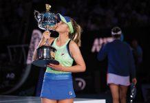 Tennis champion Sofia Kenin kissing a trophy