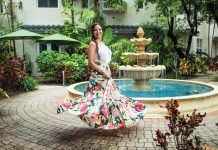 Boutique owner Michelle DiMarco at an outdoor patio in front of a fountain