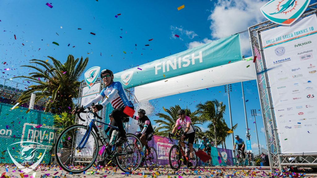 Dolphins Challenge Cancer participants cross the finish line at Hard Rock Stadium at thr 2019 event. Courtesy of Miami Dolphins