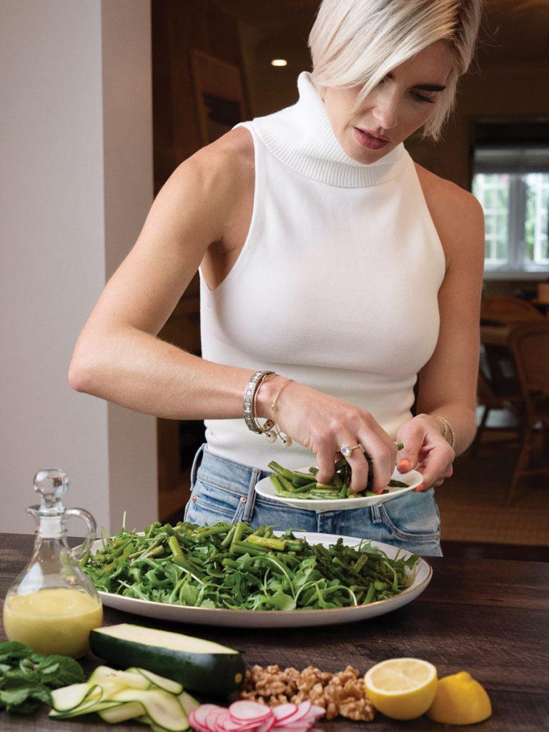 Ivey prepares her Spring Vegetable Salad. Photos by Kent Anderson