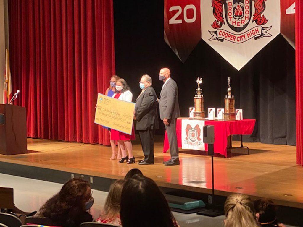 Sabrina Rapoport receives her scholarship.