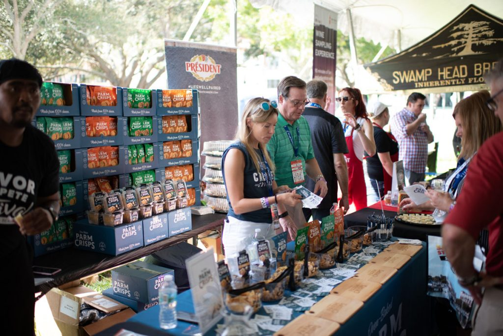 Vendors talk to guests at a previous year's Savor St. Pete event.