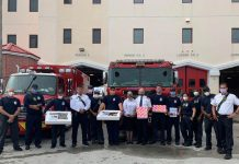 The Fort Lauderdale Fire Rescue Station No. 2 was one of the stops for The Salvation Army of Broward County's Major Connie Long and Major Stephen Long (center) last year.