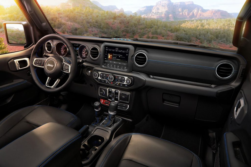 Interior of the 2021 Jeep® Wrangler Rubicon 4xe includes Surf Blue accent stitching on seats and interior trim.