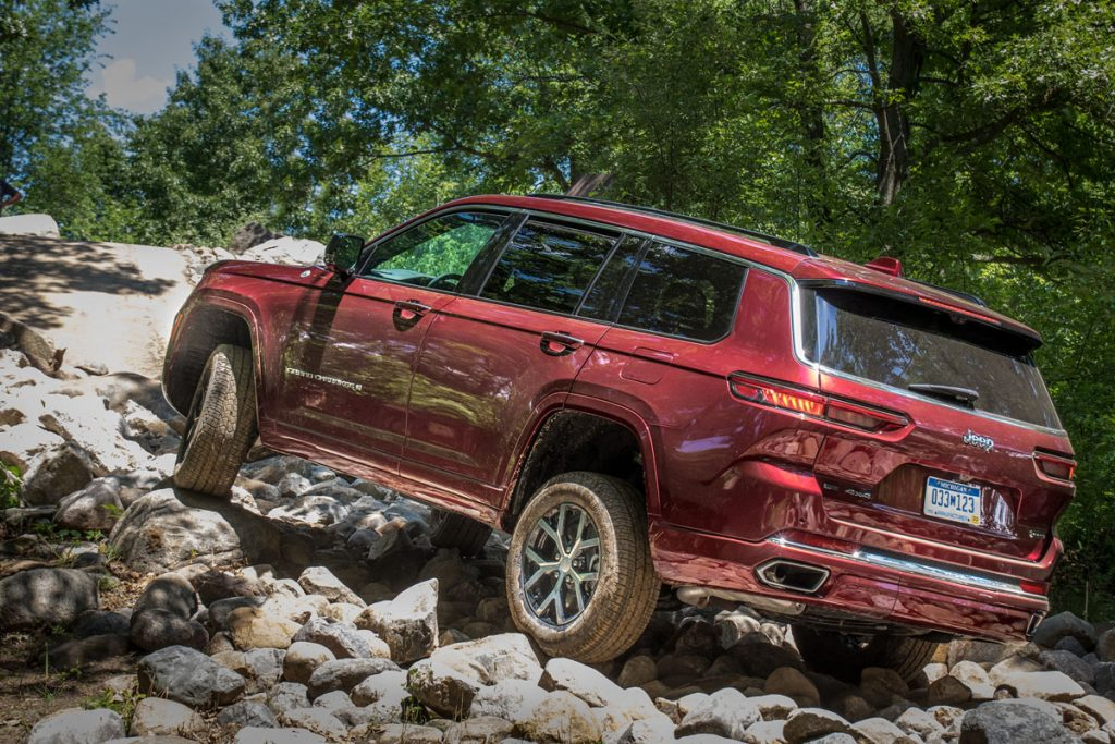 Jeep Grand Cherokee L off-roading, up a rocky hill
