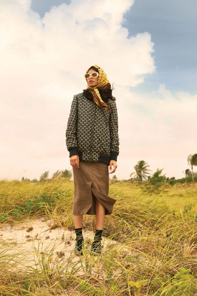Lilly Reilly wearing Max Mara scarf, bomber jacket, cashmere skirt, shoes; Alexander McQueen sunglasses, photo by Gabor Jurina