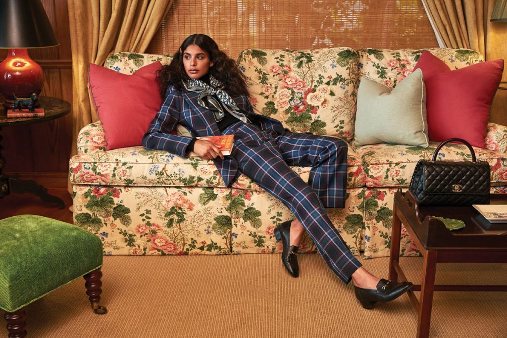 Lilly Reilly wearing Tommy Hilfiger checked blazer, tailored pants; Tory Burch turtle- neck; Dior scarf; Versace hair pin; Gucci horsebit loafers; Chanel handbag, photo by Gabor jurina