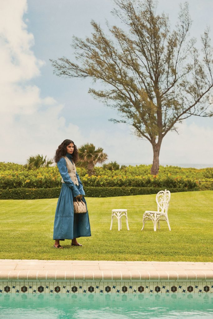 Lilly Reilly wearing Tory Burch chambray blouse, skirt, wool vest, gloves, handbag, loafers, photo by Gabor Jurina