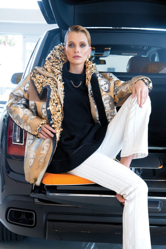 Louis Vuitton denim jeans, pullover, Louis Vuit- ton x Fornasetti metallic parka, Photo by Navid