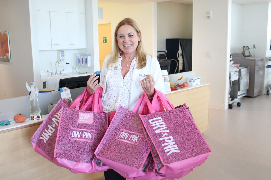 In celebration of AutoNation's 6th Annual DRVPNK Across America Day, comfort bags for cancer patients will be delivered to local South Florida hospitals. Photo courtesy of AutoNation