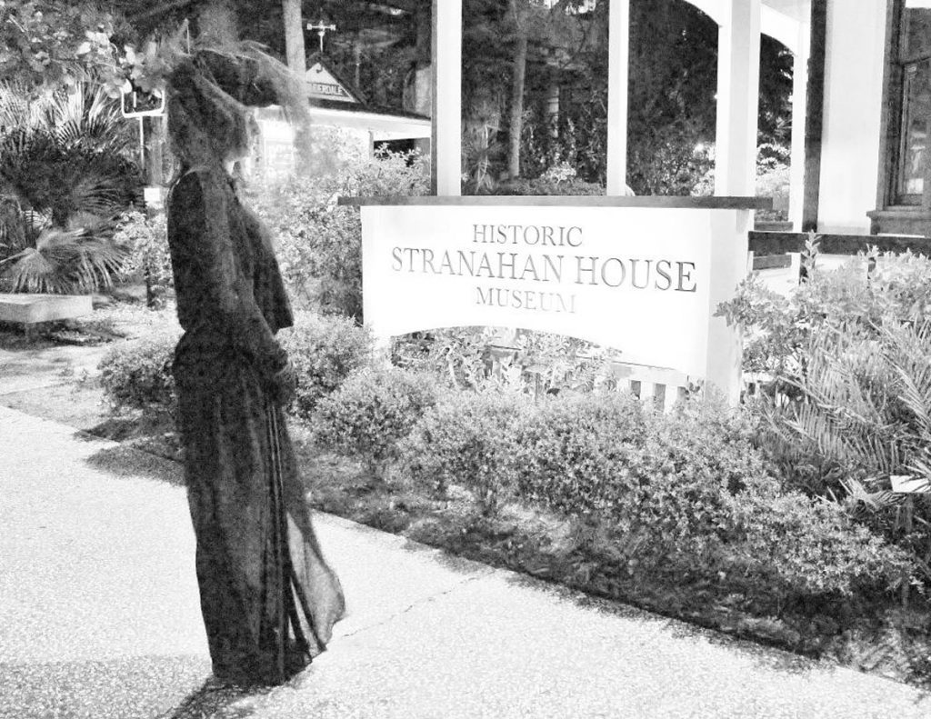 Stranahan House Halloween - Woman and Sign